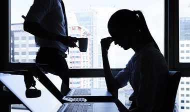 Stressed office worker at computer